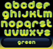 Fresh Green Font. Glowing Green Font, blurred vector alphabet isolated on black background Stock Photography