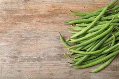Fresh green French beans. On wooden table stock photo