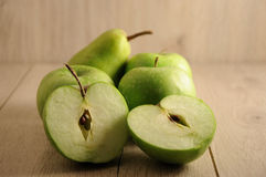 The fresh green fruits on wooden background, veggie or healthy lifestyle concept Stock Photography