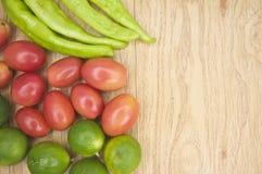 Fresh green goat pepper tomato and lemon on side Royalty Free Stock Photos