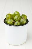 Fresh green gooseberries in an enamel mug Royalty Free Stock Image