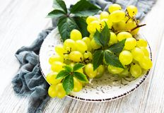 Fresh green grape. On a old wooden table stock image