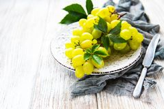 Fresh green grape. On a old wooden table stock images