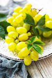 Fresh green grape. On a old wooden table stock photography