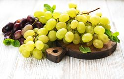 Fresh green grape. On a old wooden table royalty free stock photos