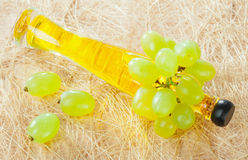 Fresh green grapes and a bottle of natural oil Royalty Free Stock Photos