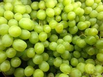 Fresh green grapes. Close-up shot of green grapes from a market stock images