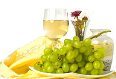 Fresh green grapes and a glass of white wine Stock Photo