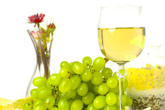 Fresh green grapes and a glass of white wine Royalty Free Stock Photo