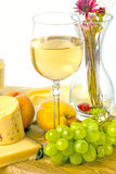 Fresh green grapes and a glass of white wine Royalty Free Stock Photos
