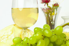 Fresh green grapes and a glass of white wine Stock Images