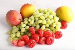 Fresh green grapes , mangoes and berrys. Royalty Free Stock Photo