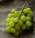 Fresh green grapes over rustic background Stock Images
