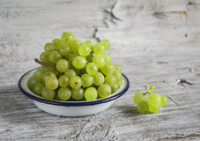 Fresh green grapes in a white enamel bowl Royalty Free Stock Image