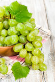 Fresh green grapes in a wooden bowl Stock Image