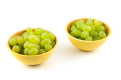 Fresh green grapes in yellow bowls Stock Photography