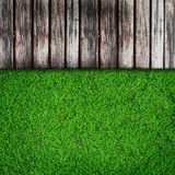 Fresh green grass and Wood Royalty Free Stock Images