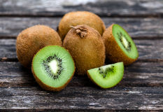 Fresh Green healthy Kiwi Fruits Full and Sliced on Wooden Table Background. rich with vitamin Royalty Free Stock Photo