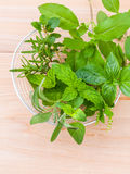 Fresh green herbs harvest from garden in the basket on wooden  b Stock Photo