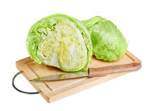 Fresh green iceberg lettuce with knife on board Royalty Free Stock Image