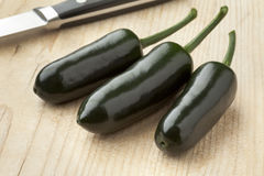 Fresh green Jalapeno chili peppers Stock Photo