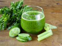 Fresh green juice from celery, cucumbers Royalty Free Stock Photography