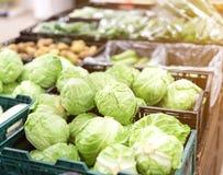 Fresh green kale on market stall. Fresh spring green kale on market stall in basket Royalty Free Stock Photo