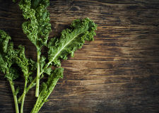 Fresh Green Kale on wooden background Royalty Free Stock Image