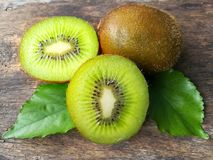 Fresh green kiwi, delicious slice fruit, arrange beautiful, wooden background. Fresh green kiwi cut half arrange beautiful on white background, delicious slice Royalty Free Stock Image