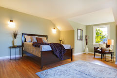 Fresh green large bedroom with modern brown bed. Modern fresh bedroom wtih oak floor and browns bed Stock Images