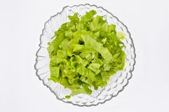 Fresh green lettuce leaves, ideal for diet, lettuce salad. Fresh green lettuce leaves, lettuce salad in glass plate, ideal for diet, isolated on white background stock photography