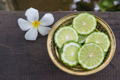 Fresh Green Lime on golden bowl 1 Royalty Free Stock Photos