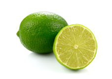Fresh green lime isolated on white background. Green lime isolated on white background stock images