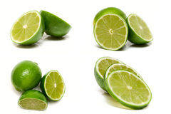 Fresh green limes. Fresh cut green limes on white Stock Images