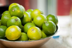 Fresh green limes in a bowl stock photography
