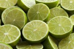 Fresh green limes. Fresh cut green limes full frame Royalty Free Stock Image
