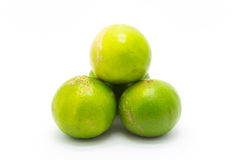 Fresh green limes on white background Stock Photos
