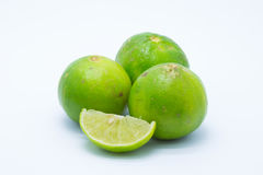 Fresh green limes on white Stock Images