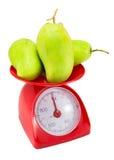 Fresh Green mango on weight scale Stock Photo