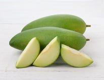 Fresh green mango on white wooden Royalty Free Stock Photo
