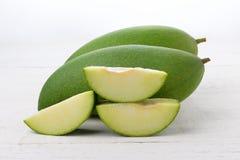 Fresh green mango on white wooden Royalty Free Stock Photography