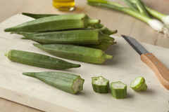 Fresh green okra. On a wooden cutting board Stock Photography