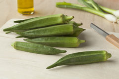 Fresh green okra. On a wooden cutting board Stock Photos