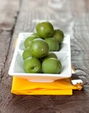 Fresh green olives on bowl Stock Photos