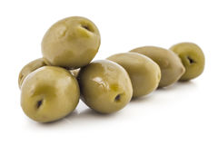Fresh green olives. Heap of fresh raw green olives, isolated on white background Royalty Free Stock Image