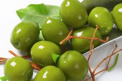 Fresh green olives. On metal scoop Royalty Free Stock Photography