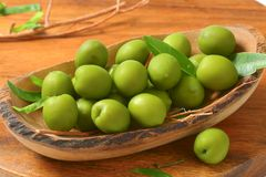 Fresh green olives. In natural wood bowl Royalty Free Stock Photo