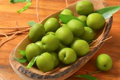 Fresh green olives. In natural wood bowl Royalty Free Stock Photography