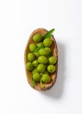 Fresh green olives. In natural wood bowl Royalty Free Stock Photos