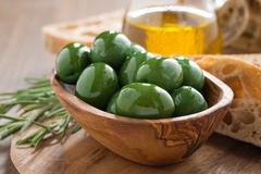 Fresh green olives, olive oil and bread Royalty Free Stock Photography